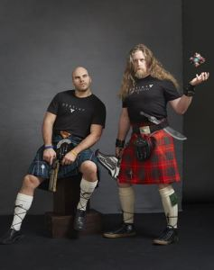 Videogame creators pose in kilts with replica props