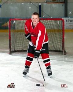 Bretton, posing in hockey gear