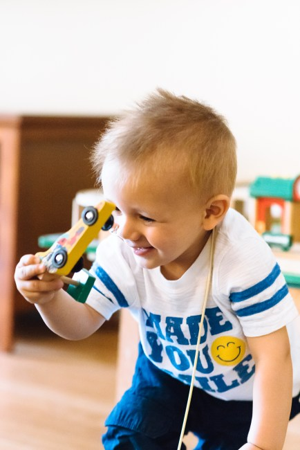 Alex plays with a toy car at the Ronald McDonald House in Seattle