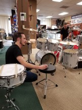 Joseph after tuning a Ludwig snare drum ha