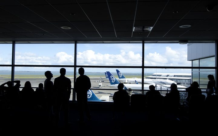 Passengers wait for their flights at Auckland Airport.