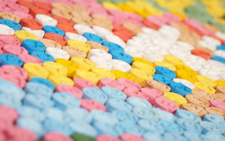 detail of pills of mdma distributed by drug dealer seized by legal authority.