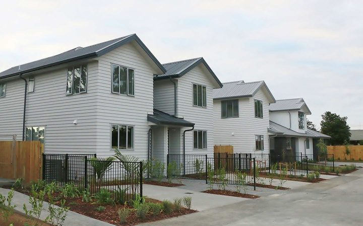 A row of 2 storey new buildings