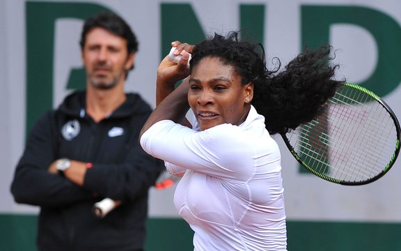 Serena Williams trains under the watchful eye of coach Patrick Mouratoglou.
