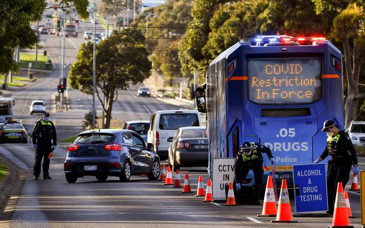 Police pull vehicles aside at a checkpoint in the locked-down suburb of Broadmeadows in Melbourne on July 2, 2020.