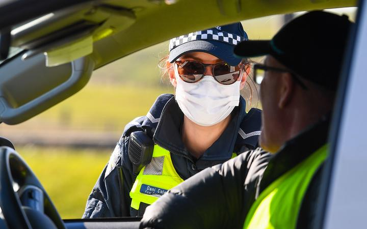 Police conduct roadside checks on the outskirts of Melbourne on July  9, 2020 on the first day of the cityÂ's new lockdown after an outbreak of the COVID-19 coronavirus.