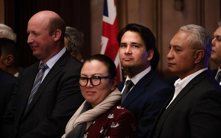 Former National Party leader Simon Bridges stands with other members of the party after Judith Collins is announced as the new leader, taking over from Todd Muller.
