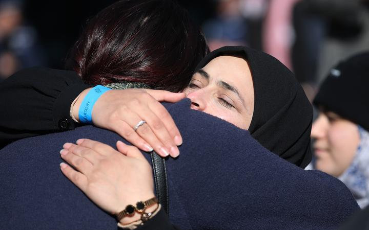 A family member of a victim thanks and celebrates with a member of the public outside the High Court after the judgement and the last day of the sentencing hearing for Australian white supremacist Brenton Tarrant in Christchurchon August 27, 2020. -