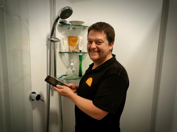 Sustainability Trust home assessor Karl Wheddon says phones in the shower are hampering efforts to cut energy and water usage