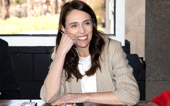 New Zealand Prime Minister Jacinda Ardern speaks with senior members of parliament a day after her landslide election win, in Auckland on October 18, 2020.