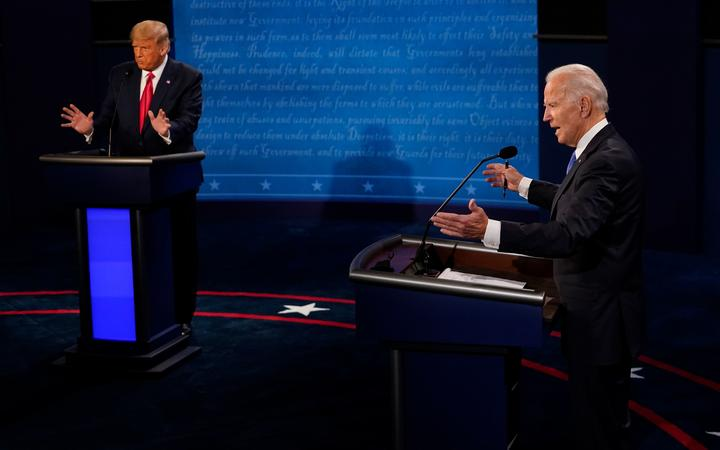 NASHVILLE, TENNESSEE - OCTOBER 22: Democratic presidential candidate former Vice President Joe Biden answers a question as President Donald Trump listens during the second and final presidential debate at Belmont University on October 22, 2020 in Nashville, Tennessee.