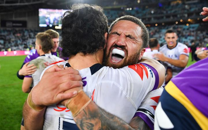 Storm back-rower Kenny Bromwich celebrates winning the 2020 NRL grand final.