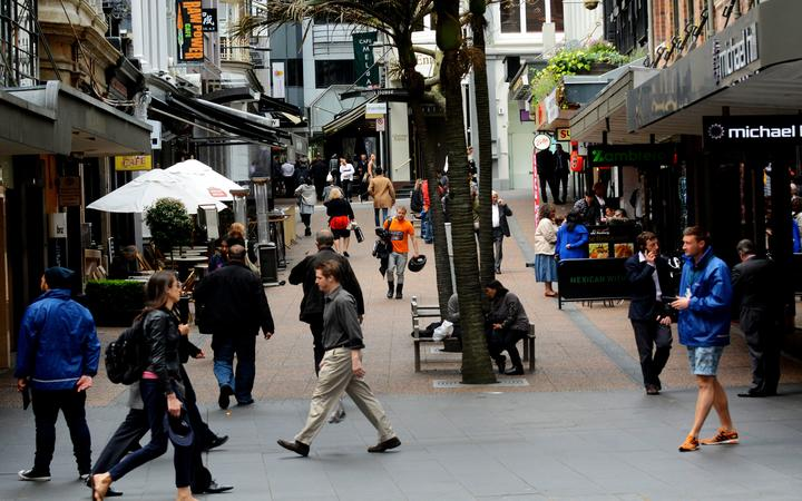 AUCKLAND,NZ - OCT 13 2015:Traffic on Vulcan Lane in Auckland downtown, New Zealand .It's a popular cobblestone plaza off Queen St home to fashionable restaurants, cafes, pubs and stores.