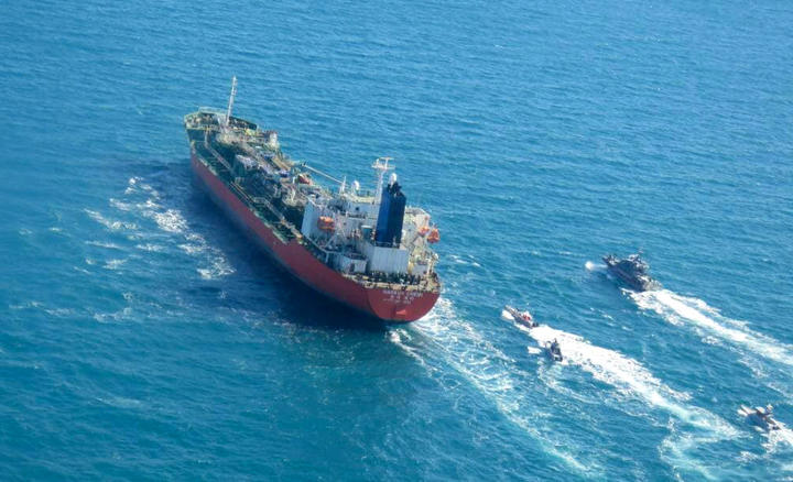 A picture obtained by AFP from the Iranian news agency Tasnim on 4 January 2021, shows the South Korean-flagged tanker being escorted by Iran's Revolutionary Guards navy after being seized in the Gulf.