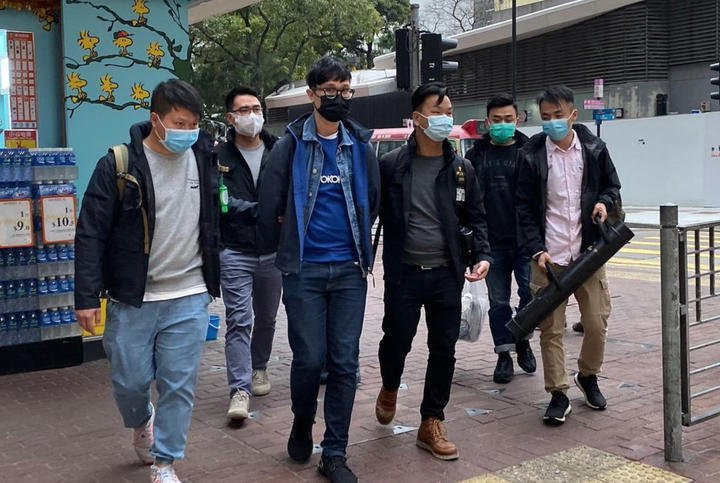 Pro-democracy activist Ventus Lau Wing-hong (third left) is arrested on 6 January 2021 in Hong Kong.