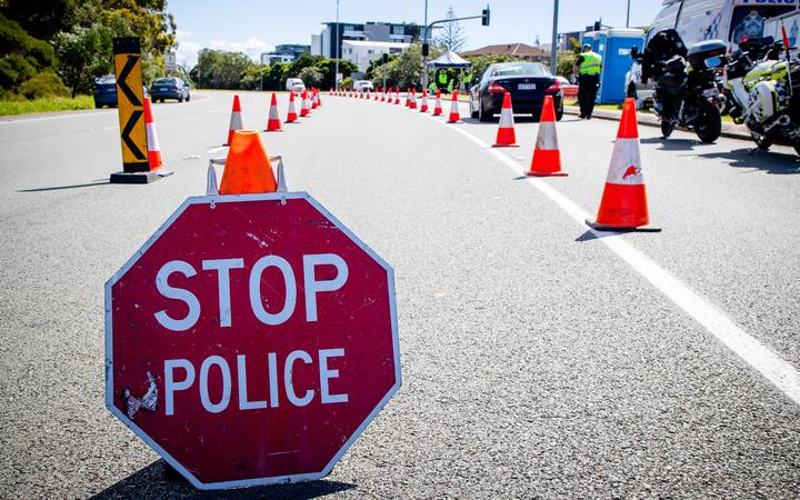 A vehicle stops at a checkpoint on the Pacific Highway on the Queensland - New South Wales border in Brisbane on April 15, 2020. -