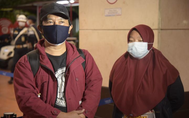 TANGGERANG, INDONESIA - JANUARY 9: Efta Kurniawan (L), a relative of the victim of a Sriwijaya Air passenger with flight number SJ 182 crashed into the sea is seen at Soekarno Hatta Airport, Indonesia on January 9, 2021.