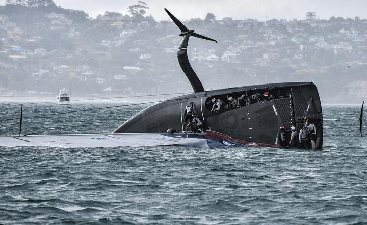 American Magic capsized just before the final leg in race three of the Prada Cup.