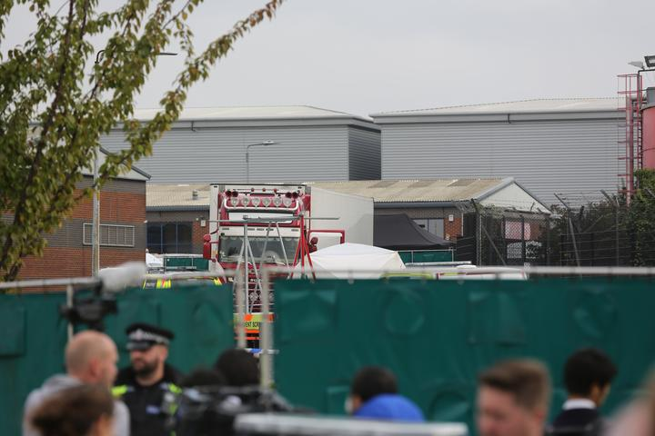 The bodies were discovered in an industrial park, east of London.
