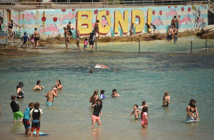 Sunbathers cool off on Bondi Beach as temperatures soar during a heatwave in Sydney on December 28, 2018.