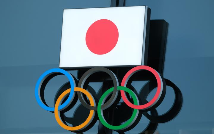 (FILES) In this file photo taken on November 15, 2020 the logo of the Japanese Olympic Committee is displayed at an entrance of the Japan Olympic Museum in Tokyo.