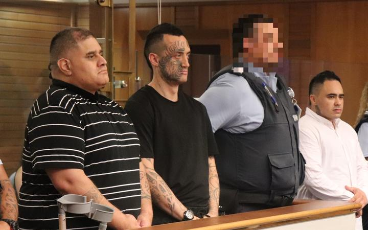 Steven Kingi (left), Jessee Burns (centre) and Stewart Hubbard (right of the guard) are heading to jail after pleading guilty to manslaughter and robbery.