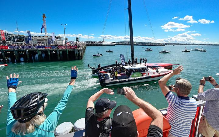 Fans and spectators wave to Emirates Team New Zealand as they leave the team base for Day 2 of the 36th America's Cup on Auckland's Hauraki Gulf in New Zealand on Friday 12th March 2021. Copright photo: Alan Lee / www.photosport.nz