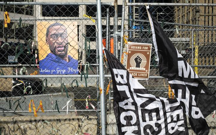 A portrait of George Floyd hangs on the fencing outside the Hennepin County Government Center on April 1, 2021 in Minneapolis, Minnesota.