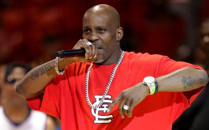 (FILES) In this file photo taken on July 23, 2017 rapper DMX performs during week five of the BIG3 three on three basketball league at UIC Pavilion in Chicago, Illinois.