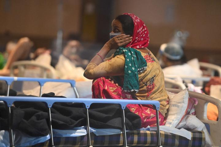 A patient rests inside a banquet hall temporarily converted into a Covid-19 ward in New Delhi on April 27, 2021.