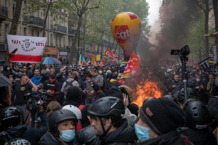 Protesters and police clashed at the beginning of a May Day march in Paris.