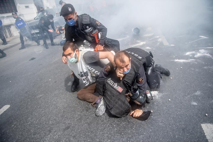 Turkish police detain demonstrators as they attempted to march on Taksim Square in Istanbul.