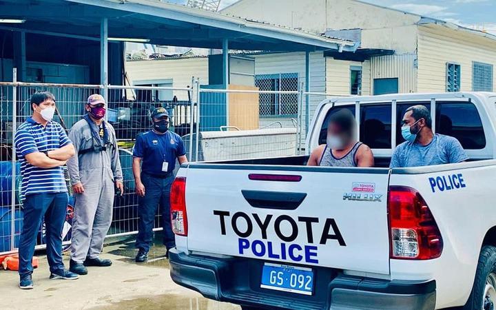 A Fijian Navy crew hand over the survivors found on board the FV TIRO II to Fiji police.
