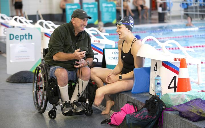 Swimmer Sophie Pascoe with her swim coach Roly Crichton at QE II Pool in New Brighton, Christchurch.