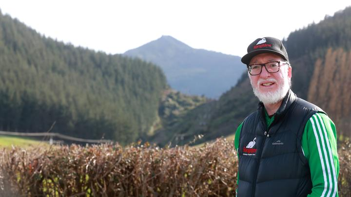 Massey University Māori historian and senior lecturer Dr Peter Meihana. The ancestress Hinekoareare was interred on the peak behind him. When the peak is called Mt Strachan that important story and its relation to other landmarks is lost.