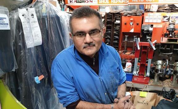 Raj runs the shoe repair shop tucked away in the James Cook Arcade.