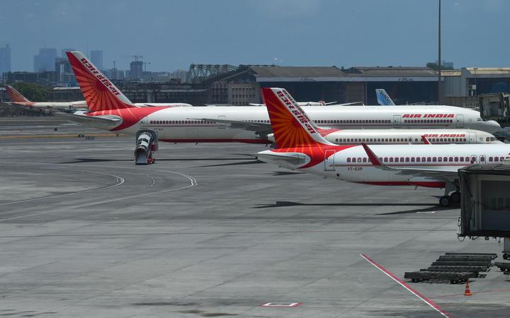 Air India aircrafts are seen parked at the Chhatrapati Shivaji Maharaj International Airport (CSMIA) after domestic flights resumed, in Mumbai on May 28, 2020.