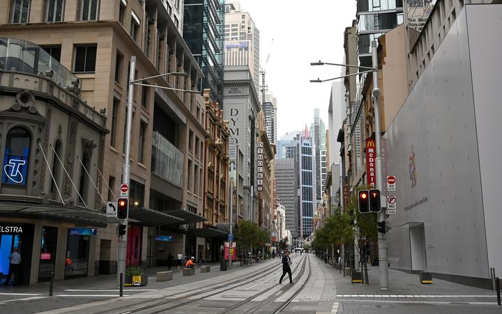 Near-deserted streets are seen in the central business district as people stay home due to the COVID-19 novel coronavirus outbreak in Sydney on March 30, 2020. - Australia has recorded almost 4,000 cases of the coronavirus, COVID-19, with the death toll rising to 17 as of March 30.