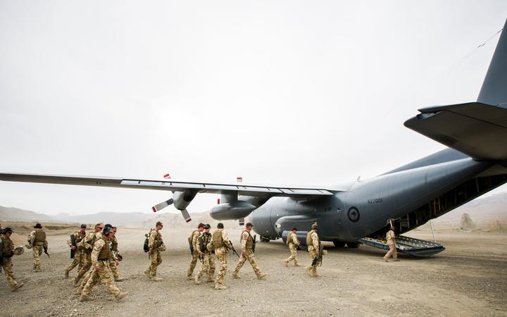 NZ Defence Force personnel boarding a Hercules plane.