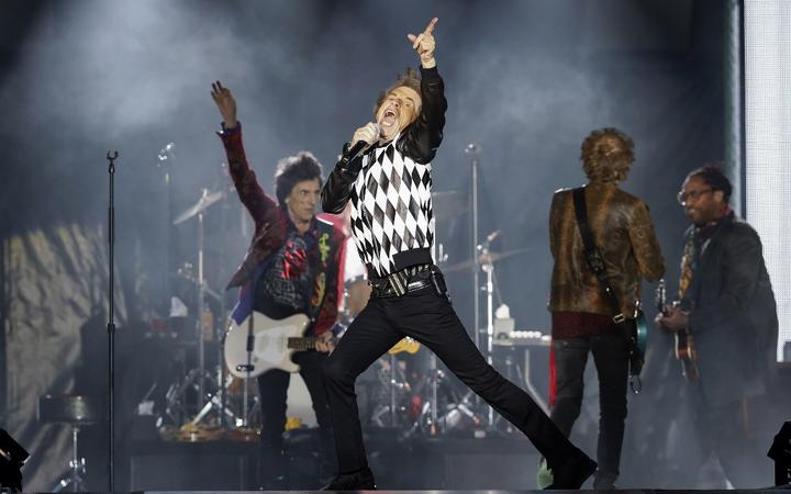 """Ronnie Wood (L), Mick Jagger (C), Charlie Watts (partially hidden) and Keith Richards of the Rolling Stones perform as they resume their """"No Filter Tour"""" North American Tour at the Soldier Field on June 21, 2019 in Chicago."""