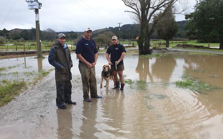 Sam Davis, centre, says three quarters of his Northland Dairy farm was underwater