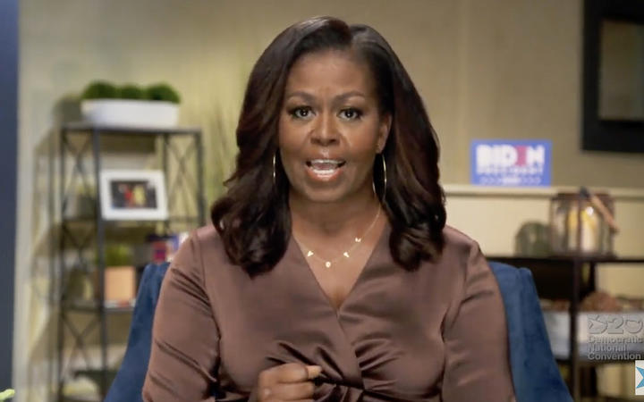 An image from the online broadcast of the Democratic National Convention, with former First Lady Michelle Obama speaking during the opening night.