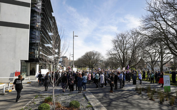 Protesters gather outside of the Canterbury Health Board corporate office on 20 August.