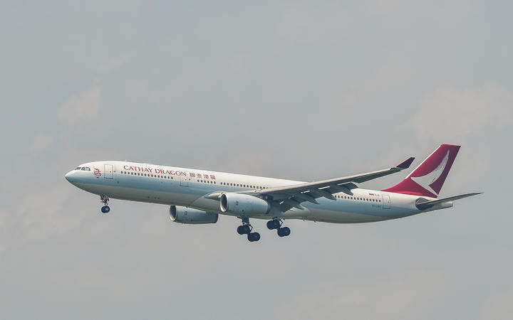 An Airbus A330-300 airplane of Cathay Dragon landing.