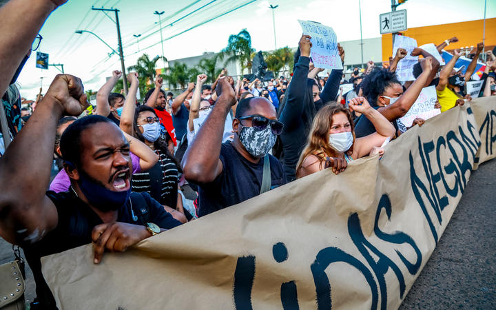 People protest against the death of a black man in front of supermarket Carrefour, where his beating took place, in Porto Alegre, Rio Grande do Sul, Brazil.