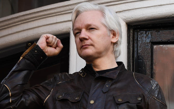 In this file photo taken on May 19, 2017 Wikileaks founder Julian Assange raises his fist prior to addressing the media on the balcony of the Embassy of Ecuador in London on May 19, 2017.