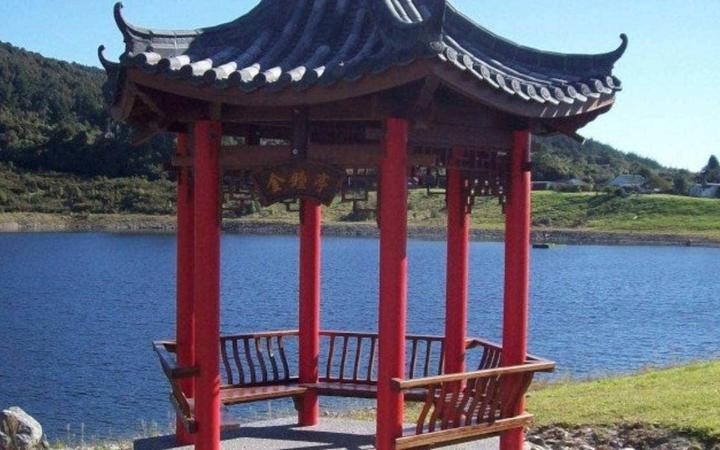 The pagoda in the Ross Memorial gardens. The lake level rose to the top of the seat when a slip changed the flow in a local creek.