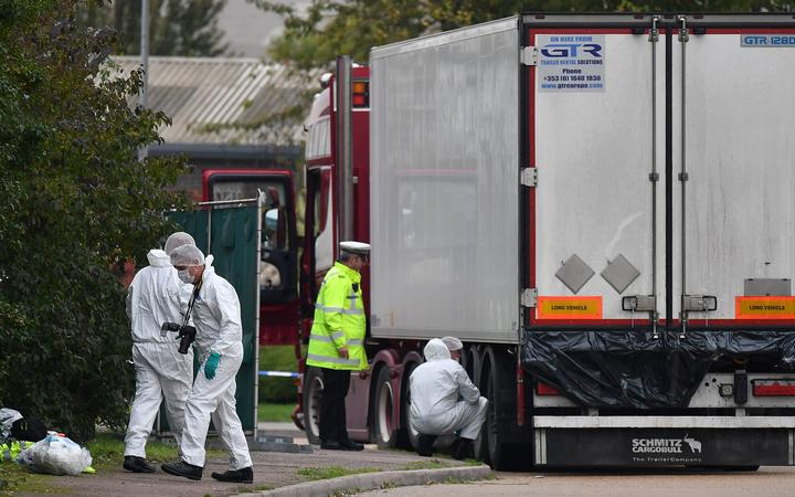 British forensics officers work on a lorry, found to be containing 39 dead bodies, east of London, 23 October 2019.