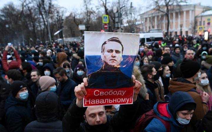 Protesters march in support of jailed opposition leader Alexei Navalny in downtown Moscow on January 23, 2021.