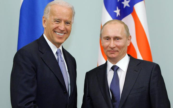 (FILES) In this file photo taken on March 10, 2011, Russian Prime Minister Vladimir Putin (R) shakes hands with US Vice President Joe Biden during their meeting in Moscow.